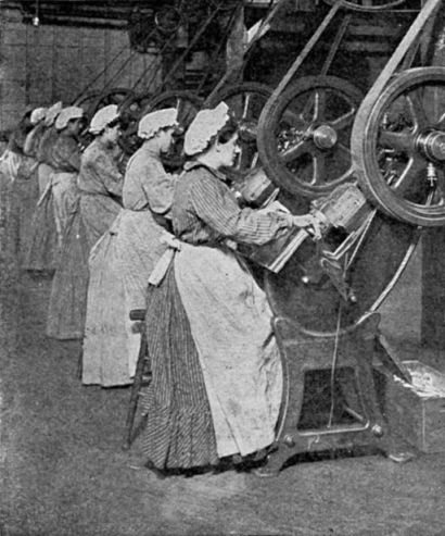 512px-Can_factory_workers_stamping_out_end_discs,_published_1909